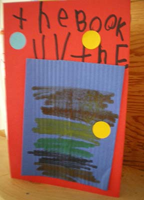 "The cover of a child's book decorated with a rectangle of corrugated paper. The text says, ""the Book UV the."""