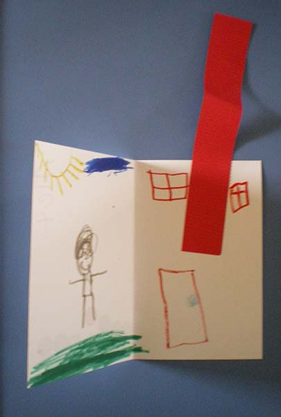 Interior of child's book showing a person and a house with a tall chimney